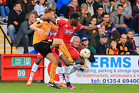 Omar Bogle fends off a tackle by Mark Roberts during the Sky Bet League 2 match between Cambridge United and Grimsby Town at the R Costings Abbey Stadium, Cambridge, England on 15 October 2016. Photo by PRiME Media Images.
