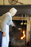 Heritage Days Festival. Union County. Colonial woman in kitchen tending iron skillet on fire.