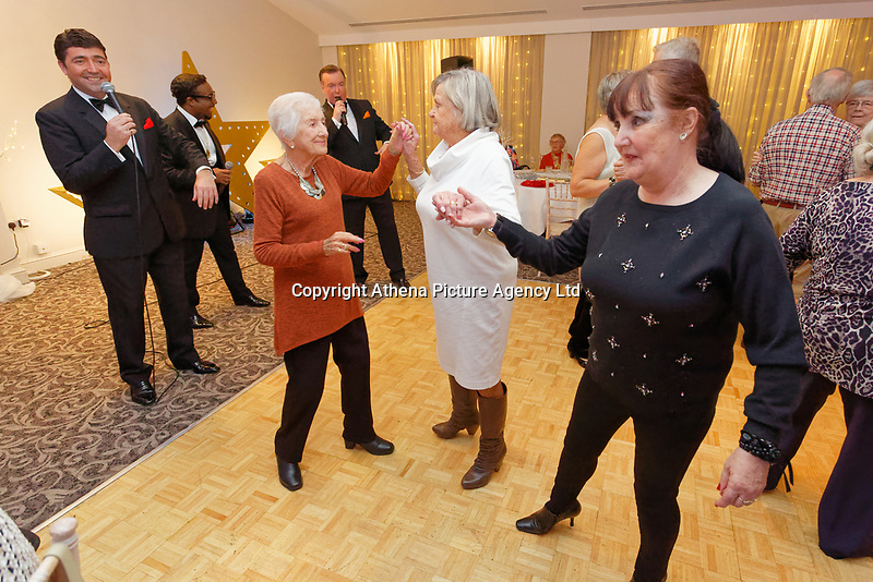 Pictured: Guests dance.  Wednesday 28 November 2018<br /> Re: National Lottery millionaires from south Wales and the south west of England have hosted a glitzy Rat Pack-inspired Christmas party for an older people's music group at The Bear Hotel in Cowbridge, Wales, UK.