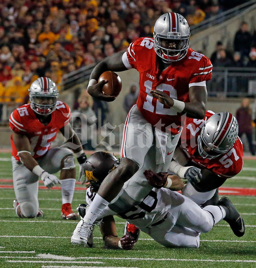 Ohio State Buckeyes quarterback Cardale Jones (12) carries the ball in the second half of their game at Ohio Stadium in Columbus, Ohio on November 7, 2015. (Columbus Dispatch photo by Brooke LaValley)