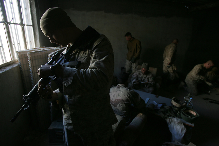 A member of Lima Co. 3rd Battalion 6th Marines prepares his weapon before the beginning of Operation Steel Curtain, an operation to clear Husaybah on the Iraq-Syrian border of insurgents on Wed. Nov. 2, 2005.