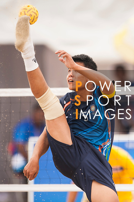 WAIKHOM Sanjeck Singh of India Team plays a shot against Thailand during their Beach Sepaktakraw Men's team competition on Day Eight of the 5th Asian Beach Games 2016 at My Khe Beach on 01 October 2016, in Danang, Vietnam. Photo by Marcio Machado / Power Sport Images