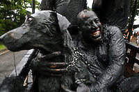 """Bloco da Lama in Paraty, Rio de Janeiro State, Brazil. Clad in swimwear and rags, slathered in mud, adorned with branches and bones and crying """"ooga ooga ha ha"""", revelers parade through the streets of Paraty's colonial district every Carnival Saturday afternoon."""