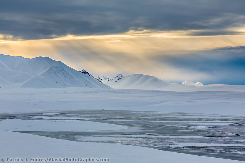 Landscape of snow covered tundra of the endicot mountains of the Brooks Range, Arctic, Alaska.