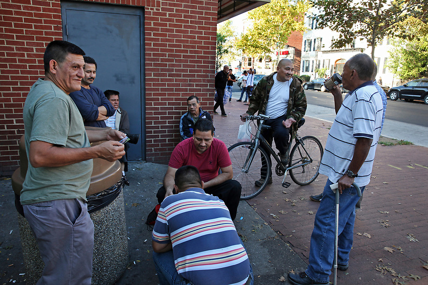 (171015RREI5505)  La Esquina where Latinos have gathered for decades at the corner of Mt. Pleasant St. and Kenyon St. NW. to play chekers (damas). Jorge (left), Pelon (bike). Washington DC Oct. 15 ,2017 . ©  Rick Reinhard  2017     email   rick@rickreinhard.com