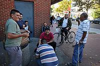 (171015RREI5505)  La Esquina where Latinos have gathered for decades at the corner of Mt. Pleasant St. and Kenyon St. NW. to play chekers (damas). Jorge (left), Pelon (bike). Washington DC Oct. 15 ,2017 . ©  Rick Reinhard  2017     email   rick@rickreinhard.com