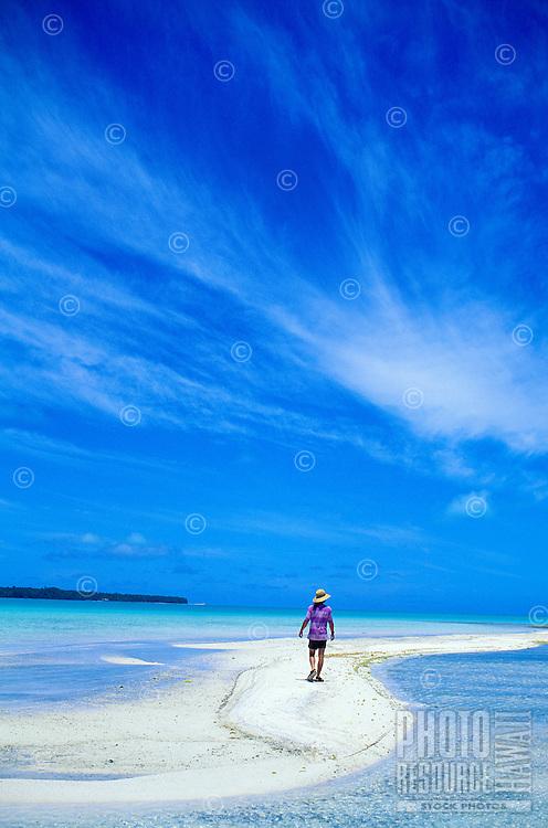 Man explores sandbar in the Aitutaki Lagoon, Aitutaki, Cook Islands