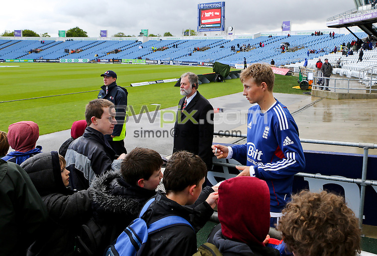PICTURE BY ALEX WHITEHEAD/SWPIX.COM - Cricket - 2nd Investec Test Match - Day 1 - England vs New Zealand - Headingley, Leeds, England - 24/05/13 - England's Joe Root signs autographs for fans.