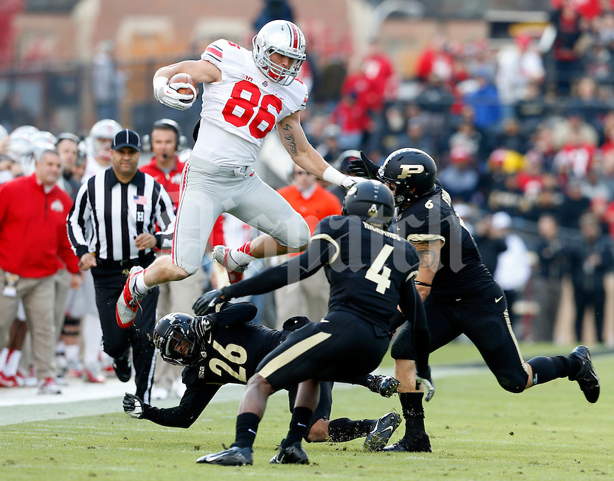 Ohio State Buckeyes tight end Jeff Heuerman (86) leaps over Purdue Boilermakers cornerback Antoine Lewis (26), safety Taylor Richards (4) and linebacker Ruben Ibarra (6) during the second quarter of the NCAA football game at Ross-Ade Stadium in West Lafayette, Ind. on Nov. 2, 2013. (Adam Cairns / The Columbus Dispatch)
