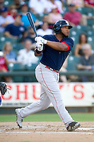Oklahoma City RedHawks first baseman Jonathan Singleton (23) follows through on his swing against the Round Rock Express during the Pacific Coast League baseball game on August 25, 2013 at the Dell Diamond in Round Rock, Texas. Round Rock defeated Oklahoma City 9-2. (Andrew Woolley/Four Seam Images)