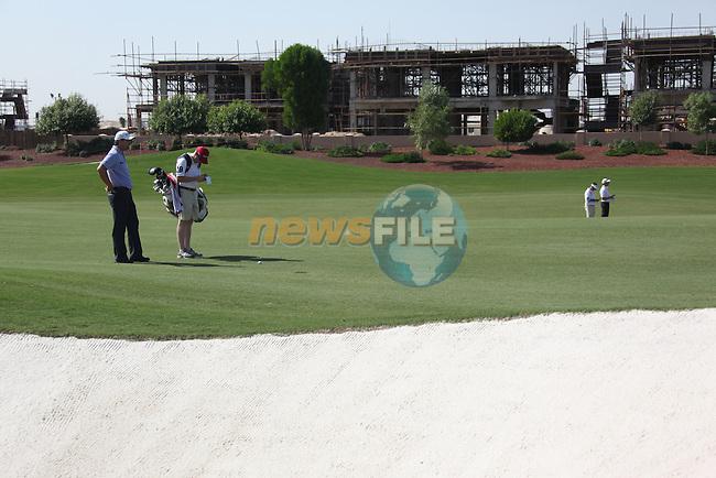 Dubai World Championship Golf. Earth Course,.Jumeirah Golf Estate, Dubai, U.A.E...Padraig harrington just missing the bunker on the 3rd during the first round of the Dubai World Golf championship..Photo: Fran Caffrey/www.golffile.ie...