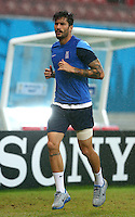 Panagiotis Kone of Greece goes through a fitness test away from the main group as he recovers from a hamstring injury suffered in the last match