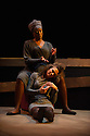 London, UK. 21.10.2013. Theatre Royal Stratford East presents CROWNING GLORY, by Somalia Seaton. Directed by Dawn Reid. Lighting design by Chloe Kenward. Set and costume design by Nick Barnes. Picture shows: T'Nia Miller (Bal-Ead) and Lorna Brown (Panther). Photograph © Jane Hobson.