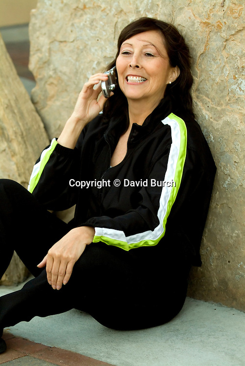 Mature woman talking on cellular phone, smiling, close-up
