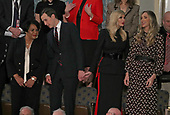 Senior Advisor Jared Kushner, second left, converses with Alice Johnson, left, who had been serving a mandatory life sentence without parole for charges associated with a nonviolent drug case, as he holds hands with his wife First Daughter and Advisor to the President Ivanka Trump, second left, who is in conversation with Lara Trump, right, prior to United States President Donald J. Trump delivering his second annual State of the Union Address to a joint session of the US Congress in the US Capitol in Washington, DC on Tuesday, February 5, 2019.  Kushner and actress Kim Kardashian brought Johnson's case to the President who granted her clemency on June 6, 2018. <br /> Credit: Alex Edelman / CNP