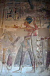 "Wall releif of Ramses III in a Portico with Hypostyle in the second forecourt at the mortuary temple of Ramses III at Medinet Habu at Thebes.Thebes was the ancient capital of Egypt and was built in and around modern day Luxor.The ancient name for Medinet Habu was Djamet meaning ""males and mothers."" Its holy ground was believed to be where the Ogdoad,the four pairs of primeval gods,were buried.Medinet Habu was both a temple and a complex of temples.Queen Hatshepsut who ruled Egypt from 1479-1458 BC  and Tuthmosis III who reigned from 1479-1425 BC built a small temple to Amun on the site of an earlier structure. Next to their temple, Ramses III who reigned from 1186-1155 BC built his mortuary temple.He then enclosed both structures within a massive mud-brick enclosure.The temple precinct measures about 700 feet by 1000 feet and contains more than 75,350 sq ft of decorated surfaces across its walls.It is the best preserved of all the mortuary temples of Thebes."