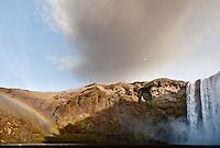 Eyjafjallajökull erupts over Skógafoss  (Skogar falls) in Iceland