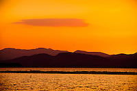©Mitch Wojnarowicz Photographer..Sunset over the Adirondack Mountains high peaks region, late October.  View across Lake Champlain from Vermont..20081031.Not a royalty free image. COPYRIGHT PROTECTED.www.mitchw.com.www.mitchwblog.com.518 843 0414_Mitchw@nycap.rr.com.ANY USE REQUIRES A WRITTEN LICENSE.NO Model release for this image
