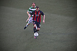 The New Saints 4 Bohemians 0, 20/07/2010. Park Hall Stadium, Champions League 2nd qualifying round 2nd leg. Bohemians forward Mark Quigley shields the ball from Scott Ruscoe at Park Hall Stadium, Oswestry during his team's Champions League 2nd qualifying round 2nd leg game away to The New Saints. Despite leading 1-0 from the first leg, the Dublin club went out following their 4-0 defeat by the Welsh champions. The match was the first-ever Champions League match in the UK played on an artificial pitch and was staged at the Welsh Premier League's ground which was located over the border in England. Photo by Colin McPherson.