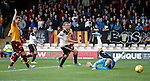 Niall McGinn's shot hits the post with the Motherwell keeper beaten
