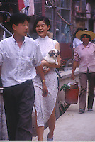 "A lady and man in a street of Huang Beiling, also known as ""Second Wife Village"" in Shenzhen, China. The ""village"" is famous for the number of second wives  living there that cater either to wealthy local men or Hong Kong men that live just across the border and visit on weekends. ..PHOTO BY SINOPIX."