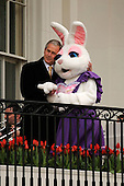 United States President George W. Bush, left, hugs Mrs. Bunny after welcoming participants to the annual White House Easter Egg Roll March 24, 2008 on the South Lawn of the White House in Washington, DC. The Easter Egg Roll is a traditional all-American event held on the White House lawn each year since 1878, where kids compete by using a giant wooden spoon to push and egg.  <br /> Credit: Ken Cedeno / Pool via CNP