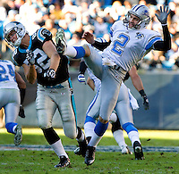 Carolina Panthers linebacker Jon Beason (52) and Detroit Lions punter Nick Harris (2) during an NFL football game at Bank of America Stadium in Charlotte, NC.