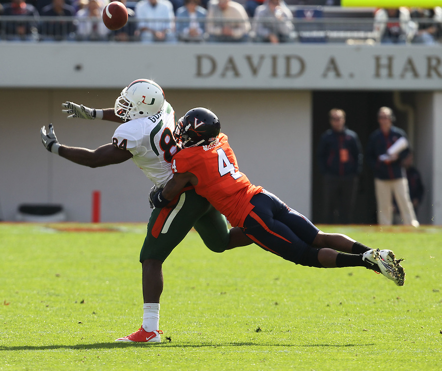 Oct 30, 2010; Charlottesville, VA, USA;   Miami Hurricanes tight end Richard Gordon (84) misses a pass while being defended by Virginia Cavaliers safety Rodney McLeod (4) during the 1st half of the game at Scott Stadium.  Mandatory Credit: Andrew Shurtleff