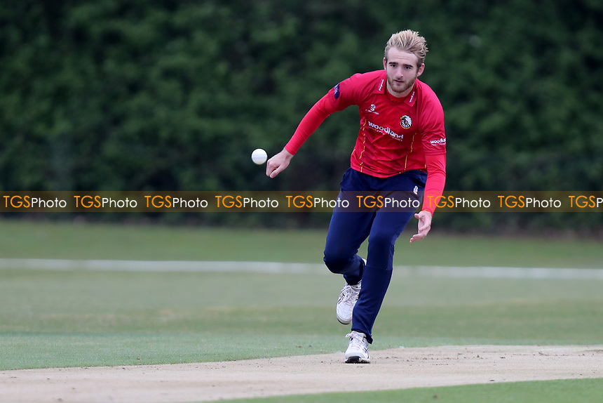 Essex bowler Paul Walter retrieves the ball whilst in bowling action during Essex CCC 2nd XI vs Surrey CCC 2nd XI, Second XI Trophy Cricket at Billericay Cricket Club on 3rd May 2017