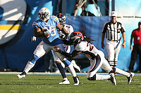 11/27/11 San Diego, CA: San Diego Chargers running back Mike Tolbert #35 and Denver Broncos free safety Quinton Carter #28 during an NFL game played between the Denver Broncos and the San Diego Chargers at Qualcomm Stadium. The Broncos defeated the Chargers 16-13 in OT