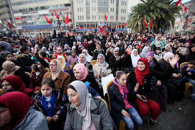 """Palestinian women watch Muslim Sufis as they play musical instruments during a ceremony commemorating the birth of Prophet Mohammed, known in Arabic as """"Mawlid al-Nabawi"""", in the West Bank city of Nablus on December 11, 2016. Photo by Nedal Eshtayah"""