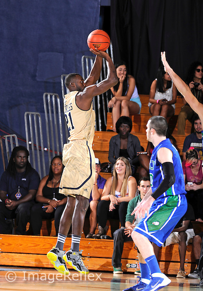 Florida International University forward Rakeem Buckles (21) plays against Florida Gulf Coast University.  FIU won the game 72-61 on December 7, 2013 at Miami, Florida.