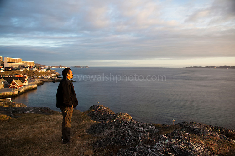 Greenlandic man over looks the old Harbour, Nuuk, 19th June 2009, two days before Greenland attains self-governance. (c) 2009 Dave Walsh