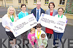 OWEN to FINISH.FUNDRAISER: Three Milltown women who ran the Dingle Marathon recently presenting the proceeds to the Cashel Ward of Kerry General Hospital and the Nagle-Rice Primary School in Milltown on Friday, front Anne O'Shea-Daly with ...... Back l-r: Angela Josey, Helen O'Sullivan (Cashel Ward), Liam Fell (School principal), Mary Ellen O'Connor, Emma Daly.