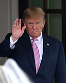 United States President Donald J. Trump waves to President Abdel-Fattah el-Sisi of the Arab Republic of Egypt as he departs in his limo following their meeting at the White House in Washington, DC on April 9, 2019.<br /> Credit: Ron Sachs / CNP