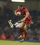 Fiji scrum half Nikola Matawalu tackles Wales centre Jamie Roberts.<br /> Dove Men Series 2014<br /> Wales v Fiji<br /> Millennium Stadium<br /> 15.11.14<br /> &copy;Steve Pope-SPORTINGWALES