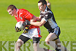 Ardfert's Niall Clifford and St Pats Gary Savage.