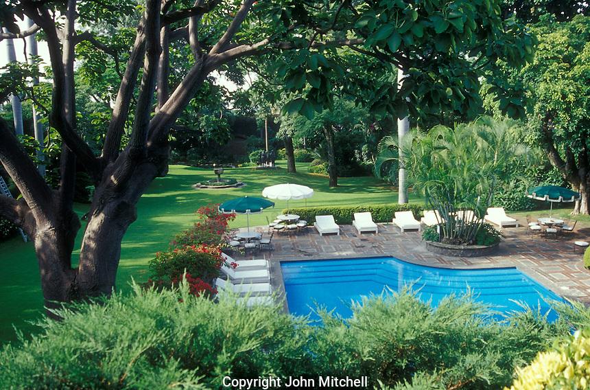 Swimming pool and gardens at Las Mananitas hotel in Cuernavaca, Mexico