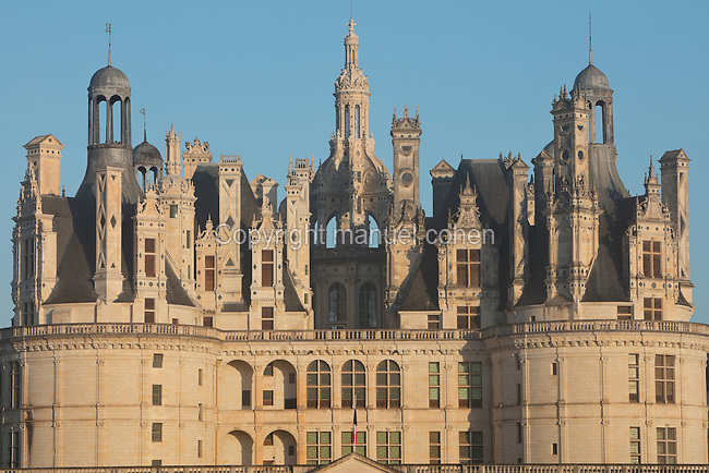 Chateau de Chambord with its central lantern tower and 2 of the 4 bastion towers surrounding the central keep, designed by Domenico da Cortona and built 1519-47 in French Renaissance style under King Francois I, at Chambord, Loir-et-Cher, France. The largest of the Loire Valley chateaux, Chambord has a moat and an elaborate decorative roofline. The chateau was listed as a UNESCO World Heritage Site in 1981. Picture by Manuel Cohen