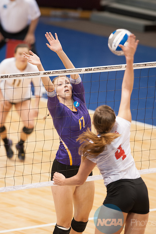21 NOV 2015: Cal Lutheran's Michelle Lawrence leaps up to block a spike attempt by Wittenberg's Melissa Emming during the Division III Women's Volleyball Championship held at Van Noord Arena on the Calvin University campus in Grand Rapids, MI. Cal Lutheran defeated Wittenberg 3-0 for the national title. Erik Holladay/NCAA Photos
