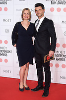 Simone Lahbib and Raffaello Degruttola arriving for the Moet British Independent Film Awards 2014, London. 07/12/2014 Picture by: Alexandra Glen / Featureflash
