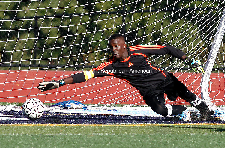 Oxford, CT- 22 September 2014-092214CM09-  Wilby goal keeper Tyriq Harris is unable to make a safe kicked in by Oxford's Joshua Selgado during their NVL matchup on Monday.  Christopher Massa Republican-American