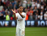 Pictured: Kyle Naughton of Swansea thanks home supporters after the end of the game Sunday 30 August 2015<br /> Re: Premier League, Swansea v Manchester United at the Liberty Stadium, Swansea, UK