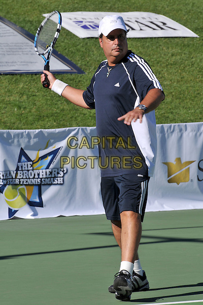 JON LOVITZ .The Bryan Brothers? All-Star Tennis Smash 2008 at the Sherwood Country Club, Thousand Oaks, California, USA, .27th September 2008.sport game sports playing full length blue navy top t-shirt cap hat shorts racquet .CAP/ADM/BP.©Byron Purvis/Admedia/Capital PIctures
