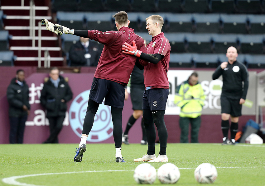 Burnley's Nick Pope is greeted by Joe Hart during the pre-match warm-up <br /> <br /> Photographer Rich Linley/CameraSport<br /> <br /> Emirates FA Cup Third Round - Burnley v Barnsley - Saturday 5th January 2019 - Turf Moor - Burnley<br />  <br /> World Copyright © 2019 CameraSport. All rights reserved. 43 Linden Ave. Countesthorpe. Leicester. England. LE8 5PG - Tel: +44 (0) 116 277 4147 - admin@camerasport.com - www.camerasport.com