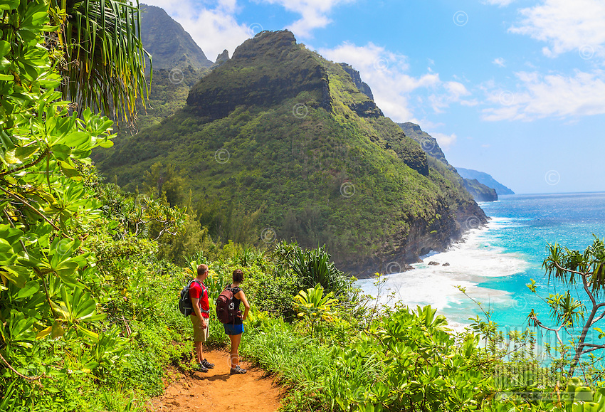 Hikers on the Kalalau Trail near Hanakapi'ai Beach, northern Kaua'i.