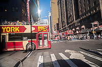 Tour buses shepherd tourists around New York on Sunday, November 8, 2015. (© Richard B. Levine)