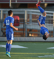 NWA Democrat-Gazette/ANDY SHUPE<br /> Rogers senior Willie Hernandez (right) flips Tuesday, April 10, 2018, after scoring a goal while celebrating with junior Felix Escobar during the second half against Springdale at Jarrell Williams Bulldog Stadium in Springdale. Visit nwadg.com/photos to see more photographs from the match.