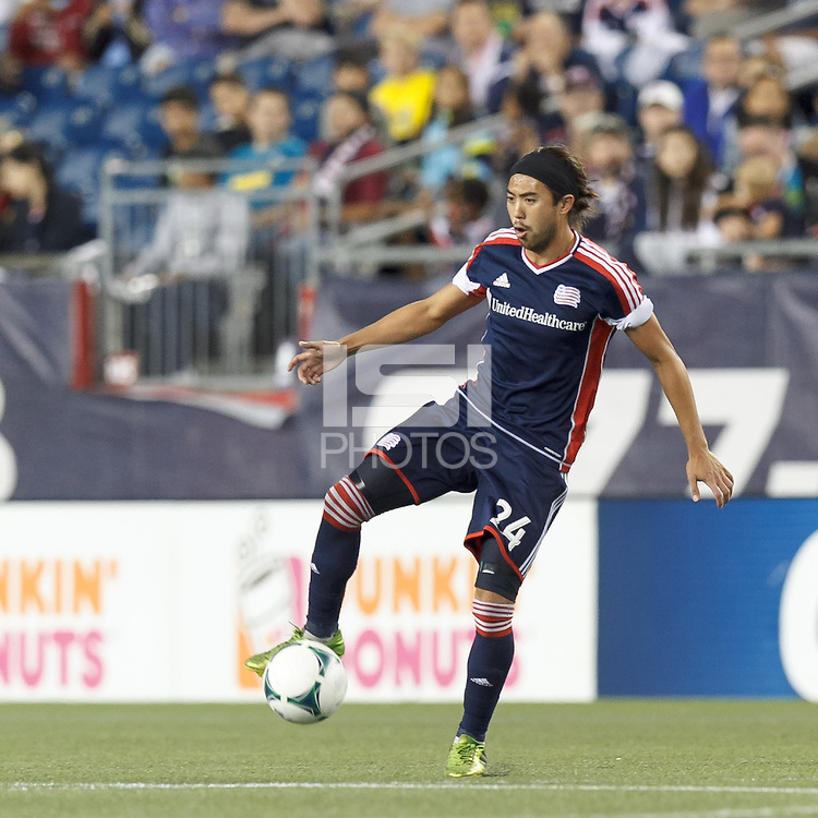 New England Revolution midfielder Lee Nguyen (24) traps the ball. In a Major League Soccer (MLS) match, the New England Revolution (dark blue) defeated Philadelphia Union (light blue), 5-1, at Gillette Stadium on August 25, 2013.