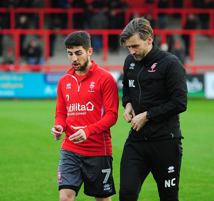 Lincoln City's Tom Pett, left, and Nicky Cowley during the pre-match warm-up<br /> <br /> Photographer Andrew Vaughan/CameraSport<br /> <br /> The EFL Sky Bet League Two - Stevenage v Lincoln City - Saturday 8th December 2018 - The Lamex Stadium - Stevenage<br /> <br /> World Copyright © 2018 CameraSport. All rights reserved. 43 Linden Ave. Countesthorpe. Leicester. England. LE8 5PG - Tel: +44 (0) 116 277 4147 - admin@camerasport.com - www.camerasport.com